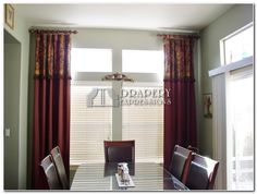 """Stationary Drapery Panels on short, 22"""" long and 2"""" in diameter rods and rings, with decorative tassel trim."""