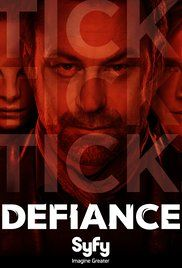 "Defiance (2013) is a post-apocalyptic sci fi western with aliens on a terraformed earth. It takes place in a town called Defiance, built over St. Louis after the terraforming. The lead character (center) has an adopted alien daughter (left), and he becomes the local ""lawkeeper,"" which is just another word for sheriff."