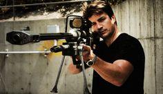 Some random guy with a sniper rifle... kinda scary. Nathan Fillion with a sniper rifle... kinda hot.