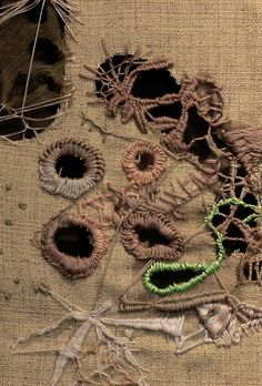 Araceli Pourcel stitching over cuts and holes to prevent fraying like society