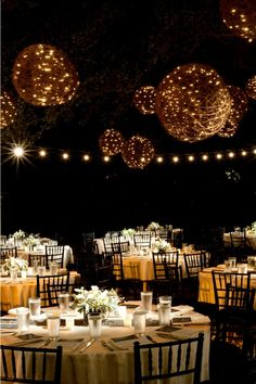 Hanging lights, or in this case, wicker balls, will make a big room feel more intimate! This is a great idea for rustic weddings in opening warehouses and barns.