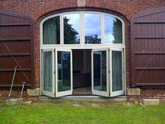 2 Wooden bi-fold doors on barn conversion by WoodenWindows, via Flickr