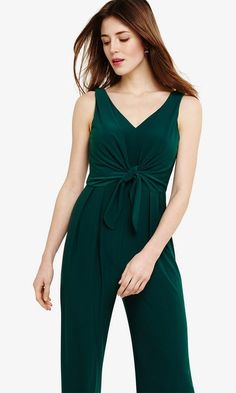An easy-to-wear jumpsuit cut with a flattering V-neckline and finished with a twist tie front to define the silhouette. Wear with metallic accessories for a stunning and contemporary evening look. Wedding Jumpsuit, Jumpsuit With Sleeves, Printed Jumpsuit, Phase Eight, Neckline, Tie, Green Weddings, How To Wear, Outfits