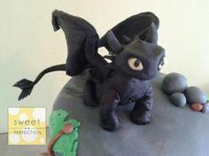 Handmade gumpaste (fondant) Toothless cake topper. How to train your dragon.