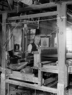 8th July 1936: The King's kilt maker Willie Meikle weaves a tartan on his loom in Kilbarchan. (Photo by Martin/Fox Photos/Getty Images)