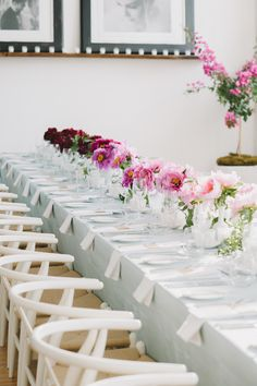 #tablescapes, #ombre, #centerpiece, #dining-chair, #pink, #magenta, #light-blue  Photography: Mango Studios - mangostudios.com  View entire slideshow: Ombre Wedding Details on http://www.stylemepretty.com/collection/1517/