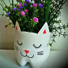 See related links to what you are looking for. Plastic Bottle Crafts, Diy Bottle, Recycled Planters, Diy And Crafts, Arts And Crafts, Decorated Flower Pots, Girl Scout Crafts, Plastic Planter, Diy Recycle