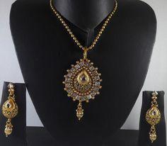Buy designer white stones pendant set with gold tone chain