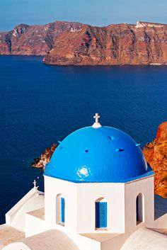 The blue domed churches, the white caldera and the blue Aegean Sea make the Greek Island of Santorini a dream destination. And it's as beautiful in person as it is photos. Definitely one of the most beautiful places I've been. Click through to find out more.