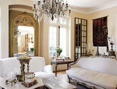 Mixing new and antique furnishings together  work well in this room, be sure and keep the fabric in the same tones... If you need color or depth add decorative accent pillows.