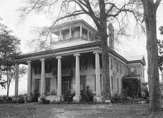 """Rosemount Plantation, nr. Forkland, Alabama; centred on a prominent star-shaped hill. """"The Grand Mansion of Alabama."""" Allen Glover, of Demopolis, gave Rosemount to his son, Williamson Allen Glover, early 1830's. Glover expanded the house through successive additions + reconfigurations. It passed through different families over the years. A massive restoration was begun around 2005, finishing the exterior. Remaining empty ever since, it is slowly being overtaken by vegetation. Added NRHP…"""