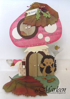 Card by DT member Marleen with Collectables Hedgehog (COL1368), Craftables Punch Die - Autumn Leaves (CR1336), Creatables Mushrooms (LR0372), Acorn with Leaf (LR0373), Garden Rake (LR0374) and Tiny's Tree & Leaf (LR0375) by Marianne Design
