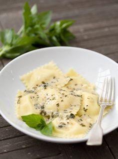 Fresh Corn Ravioli with Herb Cream Sauce. Made with flour, salt, eggs, corn kernels, whole milk ricotta cheese, heavy cream, pepper, fresh basil, fresh oregano, white wine, butter, and parsley.