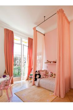 I would like this for myself. Nevermind the kids who would probably rip them out of the ceiling. lol Beautiful high curtains hung from ceiling around kid's bed!