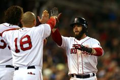 Dustin Pedroia celebrates with Shane Victorino of the Boston Red Sox after scoring in the sixth inning in Game 2 of the World Series at Fenway. Boston Red Sox Game, Dustin Pedroia, David Ortiz, Los Angeles Dodgers, World Series, Celebrities, Boys, Baby Boys, Celebs