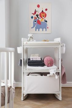 Beautiful White Wood Changing Table.... Stokke Care also converts into a bookshelf, small desk & large desk! Sustainable nursery design