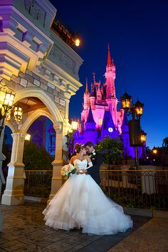 A pink and purple Cinderella Castle at dawn during a portrait session. Photo: Amy, Disney Fine Art Photography