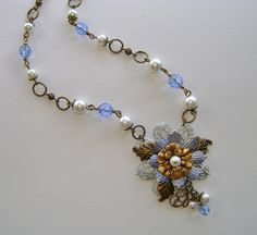 """Finish Up Friday for 10-24 by Novegatti Designs: """"Cool Blue"""" .... white- and blue-washed and natural brass components from B'Sue's, along with glass pearls and faceted beads make up this simple assemblage necklace.  www.facebook.com/NovegattiDesigns"""