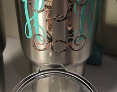 ***This listing is for the vinyl decal only, this does not include the YETI cup***  You will receive 1 monogram decal. ( lid decal also available)The middle initial will be CAMO and you will pick your solid color from the drop down below. Color shown in picture is MINT. You can find the Lid Decals in my listings to add to your order.  Color Chart located in pictures.  Decal is made with Oracal 651 Vinyl and should be hand washed with warm, soapy water. Your monogram will be vinyl. I…