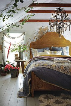 Hand-Embossed Bed - anthropologie.com....Totally not brass, but I thought it was a beautiful piece