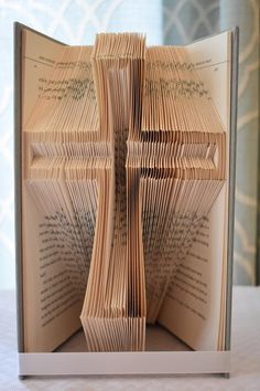 Cross folded book art This Cross is made from a recycled book. It is folded by hand by myself. Every book is made new when ordered. This would look great in anyones home Old Book Crafts, Book Page Crafts, Book Page Art, Old Book Pages, Folded Book Art, Paper Book, Book Folding Templates, Book Folding Patterns Free, Book Sculpture