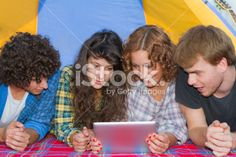Group of friends at camping with ipad #microstock #camping #ipad #tablet #friends #springbreak #digitaltablet #technology