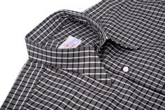 Luxire dress shirt constructed in Brown Medium Graph: http://custom.luxire.com/products/brown-medium-graph  Consists of custom spear point collar and single button square cuffs.