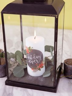 Learn how to melt napkin designs onto plain pillar candles! Such an easy and cheap craft that makes perfect gifts, decor accent or table centerpiece.