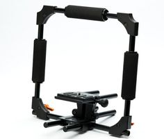 A full camera and accessories support system, the DSLR Cage from Seamless can either be hand-held or secured to a tripod. The DSLR Cage is robust and versatile but only really comes into its own when decked out with a full arsenal of photography accessories. Photography Accessories, Tripod, Arsenal, Cage, Canning, Home Canning, Conservation