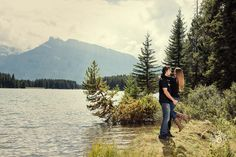 Love when we get lucky and have warm days in September! We had a chance to photograph this lovely couple at Two Jack Lake in Banff National Park! Absolutely love this image of these two next to the lake with the surround mountains and trees as the backdrop! The 38 Photography - Engagement Photography