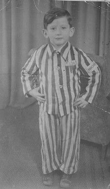 Portrait of Joseph Schleifstein wearing his concentration camp uniform a year or two after his liberation from Buchenwald concentration camp: