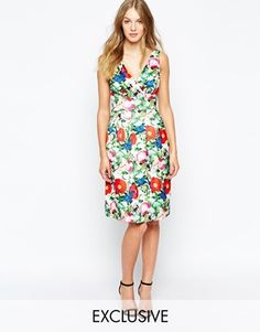 $88.04 @ Asos: This vibrant dress is fully lined, machine washable, and just waiting for your Spring wedding. (Wolf & Whistle Midi Prom Dress In Botanical Floral Print)