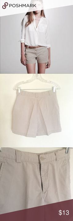 """Khakis Shorts The perfect go-to everyday shorts in Khaki/Beige that goes with everything. Zip & button closure, belt loops, slit front pockets and a smooth back makes for a flattering fit. Laying flat waist measures about 14.5"""", inseam 5"""". Dockers Shorts"""