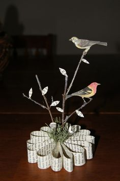 DIY Birds on Branches Book Art that is actually doable.No tutorial, but glue book pages in the flower/round formation, add floral dept fake moss/grass and branches. Use clipart birds and attach to branches.