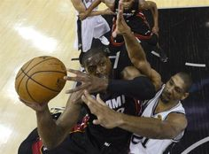 Dwyane Wade Attacks the Basket and Tim Duncan for the Lay up in Game 4 of the 2013 NBA Finals