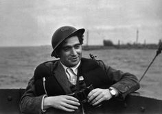 Robert Capa, 22.10.1913-25.5.1954, was a Hungarian combat photographer and photojournalist. . His action photographs, such as those taken during the 1944 Normandy invasion, portray the violence of war with unique impact. In 1947, Capa co-founded Magnum Photos with, among others, the French photographer Henri Cartier-Bresson. He was killed through a landmine in the first Indochina War.