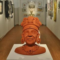 Becky Mancuso.  Mayan Dick Clark.  Earthenware.  Apocalypse themed sculpture.