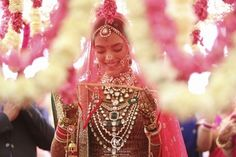 bride with veil, bride walking out with veil infront, heavy jewelled necklace, bridal haar, raani har, layered jewellery in polki and kundan