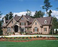 This is my dream home- not necessarily these finishes, but the plans John and I picked out for building.