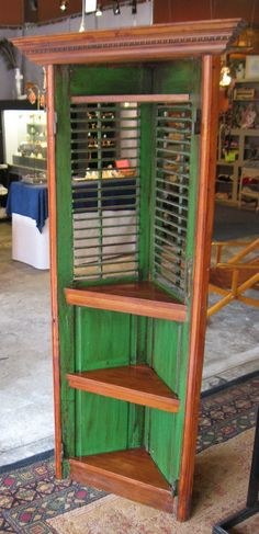 shutters upcycled into corner shelf