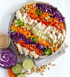 This Asian Chicken Salad with Peanut Lime Dressing is a healthy and colorful way to eat the rainbow. Few things are more exciting to me than a meal that is healthy, quick, and so colorful! This Asian Chicken Salad with Peanut Lime Dressing is going to become a quick favorite in your house because it fits