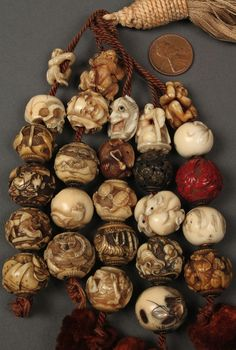 Collection of 26 Asian Ojime beads collected by George and Charles Mitchell (co-owners of Mitchell's Candy Store, Nashville) during the course of several trips to China and Japan in the late 19th-early 20th century. Mitchell estate. Sold at auction on May 21st, 2011 for $4,800.