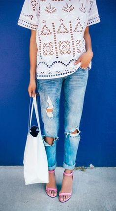 White boho top, ripped denim, and pink heels.
