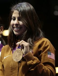 American flyweight boxer Marlen Esparza displays her bronze medal after ceremonies today at the 2012 Summer Olympic Games in London. (AP Photo/Patrick Semansky)