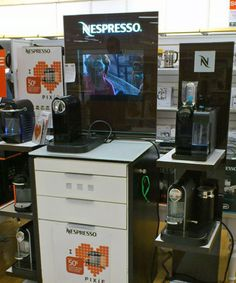 Nespresso coffee machines on display in a local store. Complete with video demo.