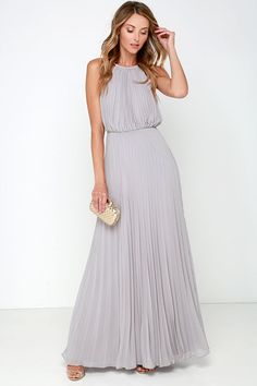From the first dance to the last, everything will be an utter dream in the Bariano Melissa Light Grey Maxi Dress! A stretchy gold coil necklace (with adjustable lobster clasp closure) creates a sultry halter neckline supporting pleated light grey chiffon. Sleeveless bodice billows into an elastic waistband before descending into an unforgettable maxi length skirt. Triangular back keyhole.