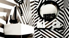 Dazzle Camo powder room via Domaine Home. LOVE LOVE LOVE! And I am so having a moment with stripes.