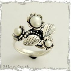 Sterling silver leaf and flowers engagement ring with fresh water pearls - Tonight.. $78.00, via Etsy.