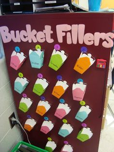 These bucket fillers are actual buckets where students could put notes or a small token (pom pom, sticker) to uplift another student. Classroom Behavior, Classroom Setup, Classroom Displays, Kindergarten Classroom, Future Classroom, School Classroom, Classroom Organization, Kindergarten Behavior System, Behaviour Management
