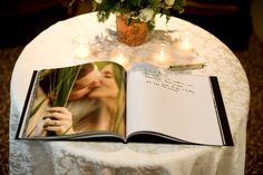 guest sign book. photo book with engagement photos in it!